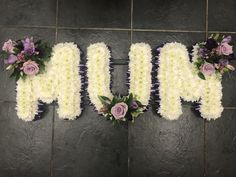 Mum funeral flowers wetter tribute, white based with lilac rose accent and lilac ribbon edge Funeral Flower Arrangements, Funeral Flowers, Wedding Flowers, Funeral Tributes, Lilac Roses, Flower Letters, Fresh Flowers, Mario, Balloons