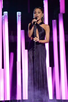 Ariana Grande looks breathtaking in a deep plum #Versace gown as she takes the stage to perform at the #Grammys2015. #VersaceCelebrities
