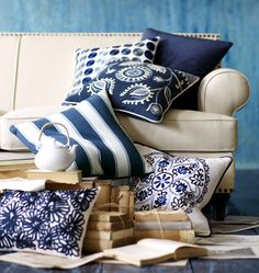 "For the ""blue room""- Mix and match blue pillows to create a cozy atmosphere."