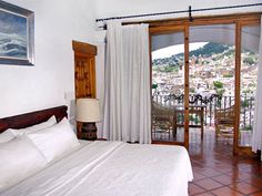 posada de la mision taxco, same curtains but the rooms used to have beautiful striped mexican blankets.