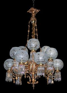 Magnificent museum quality doré bronze eighteen-arm Victorian Rococo gasolier. This antique chandelier features figural winged griffins and North Wind faces and beautiful etched glass shades.