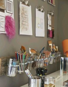 Great idea not only for an art station but for a makeup station as well. You can replace the drawings with different kinds of mirrors (regular,magnified,etc) and replace the art brushes with makeup brushes and the pencils with eyeliners,etc