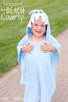 A super adorable shark that is. Have fun making this shark hooded towel project by Crazy Little Projects. Your little people will have a ball drying off in this super comfy ter Sewing Patterns For Kids, Sewing For Kids, Diy For Kids, Love Sewing, Baby Sewing, Sewing Hacks, Sewing Tutorials, Sewing Crafts, Beach Coverup Pattern