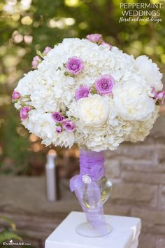 Elizabeth and Jared's wedding at The Estates of Sunnybrook. | Peppermint Weddings | Outdoor ceremony arrangement, white peonies, white hydrangeas with purple spray roses on white pedestal
