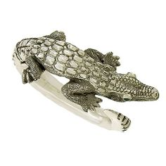 """Sterling Alligator Bracelet Ignacio 'Nacho"""" Gomez is a contemporary Mexican silversmith, and his alligator bracelet is one of his most popular creations, here on the secondary market. The hinged cuff fits a larger wrist, beautifully detailed throughout with green malachite eyes and smoothly poished round interior of the bracelet. $795"""
