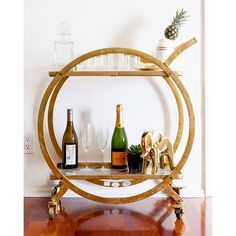 Embrace Friday with champagne and a cool art deco bar cart. #EBTH