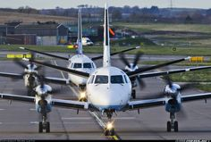 'The Saab family out in force at Aberdeen' - Big and little brother (Saab 340 + Saab 2000) taxiing to runway 34. The head on shows how similar these two airframes are. Flybe - British European (Loganair) Saab 340B  Aberdeen - Dyce (ABZ / EGPD) UK - Scotland, February 27, 2014