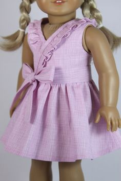 Lavender pink faux-wrap dress and sash for by dollpetitecouture (made with the Frill Seekers Dress pattern, available through PixieFaire.com)