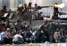 Bucharests residents protect themselves from the crossfire during clashes in the Republican square in Bucharest Romania December 23 Charles Platiau Romanian Revolution, Sign Of The Cross, Military Pictures, Crossfire, Berlin Wall, Most Powerful, Historical Pictures, Cold War, Vietnam War