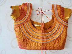 30 Latest Patch Work Saree Blouse Designs Patch work blouse designs are very attractive looking because of the work that they have. Patch work designs usually have layers of fabrics used to form different patterns and designs. And this sty… Blouse Designs High Neck, Patch Work Blouse Designs, Pattu Saree Blouse Designs, Simple Blouse Designs, Stylish Blouse Design, Fancy Blouse Designs, Latest Saree Blouse Designs, Simple Designs, Sarees