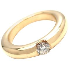 For Sale on - Yellow Gold Ellipse Diamond Band Ring by Cartier. With 11 round brilliant cut diamond clarity, G color total weight Details: Width: Wide Band Diamond Rings, Rose Gold Eternity Band, Gold Solitaire Ring, Pearl And Diamond Ring, Gold Band Ring, Gold Bands, Diamond Jewelry, White Gold Wedding Bands, Diamond Wedding Rings