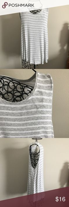 """Merona Striped Tank. Only worn once. Great condition. Cute, comfy, and Flowy. Measurements lying flat: armpit to armpit 21"""". Length of front 28"""" and length of back 31"""". Plenty of stretch.  ❌ No trades or off Poshmark transactions.   👌🏻Quick shipping.   💁🏻Offers welcome through """"Make an Offer"""" feature.   👗👠 Bundle discount.   ❔ Feel free to ask any questions. Merona Tops Tank Tops"""