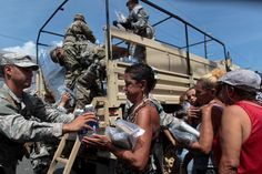 Soldiers of Puerto Rico's national guard distribute relief items to people, after the area was hit by Hurricane Maria in San Juan, Puerto Rico September REUTERS/Alvin Baez TPX IMAGES OF THE DAY - Puerto Rico, Military Personnel, The Washington Post, Virgin Islands, Natural Disasters, Drinking Water, Climate Change, Caribbean, Florida