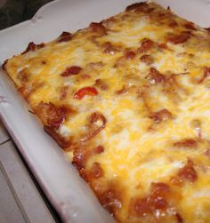 Recipe for Bacon Breakfast Bake - This DELICIOUS Breakfast Casserole is so good!! It uses tater tots instead of bread! It is comfort food at it's best!!