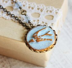 Fly Away necklace  Light Blue and gold swallow bird by rafya, $28.00