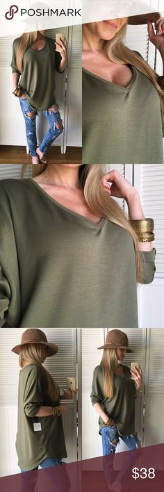 Olive Green Tunic Loving this top, I personally have owned it in a few colors for a while now and wear mine all the time. Great alone or with a cute Cardigan. Pairs cute with leggings and all denim. Love the longer length, v-neck, rolled sleeves and rounded bottom hem. Available in multiple colors   •Modeling: Small w/White  • Medium w/Denim •Fit: See First Comment Please •Material: 64% Ray, 32% Poly, 4% Span  •Ladies, PLEASE try to picture this w/o my baby belly  Tops Tunics