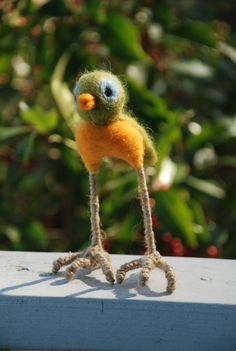 Little green canary made of felted wool with long legs.... because disportionality is cute!
