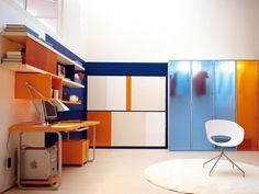 Office Room Designed With Modern Orange Desk And Bookcase On The Wall Also Transparent Closet Plus White Chair On Circle Fur Rug.