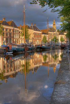 Canalhouses of Groningen reflecting in the canal. Groningen (Groningen ), The Netherlands. Places Around The World, Oh The Places You'll Go, Places To Travel, Places To Visit, Around The Worlds, Portugal, Beautiful World, Beautiful Places, Amazing Places
