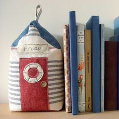 Beach hut shaped bookend or doorstop by milly and pip. Perfect gift for a seaside themed boys bedroom. Copyright © milly and pip