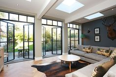The substantial extension on this detached house features bespoke art deco style steel French doors . - The substantial extension on this detached house features bespoke art deco style steel French doors … - Style At Home, Crittal Doors, Crittall Windows, Transom Windows, Fireplace Remodel, Kitchen Doors, Kitchen Extension French Doors, Open Plan Kitchen, Kitchen Ideas