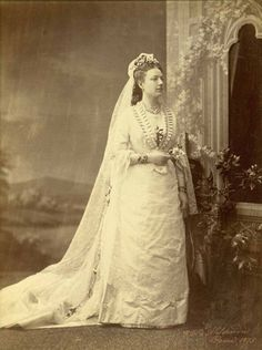 Exquisite Wedding Dresses of the 1800s (11/14) While the French were always trying new things, the Italians were simply keeping things elegant and beautiful.  This bride from 1875 in Rome has chosen a long veil and train, but kept everything else traditional.  The Italians did go a bit more elaborate with the jewelry, however!