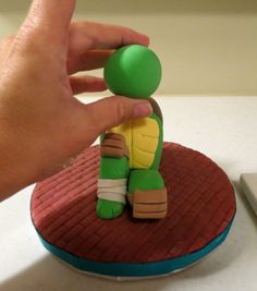 ninja turtles gum paste | At this point, the support skewer is carefully pressed down the center ...