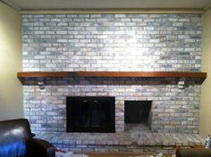 Whitewashed fireplace. Nice way to lighten a dark room.