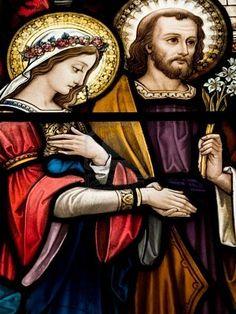 Window in catholic church in Dublin showing wedding of Mary