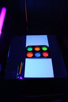 Neon paint, paper, brushes, black light from Play at Home Mom sensory Balloon Painting, Neon Painting, Light Painting, Neon Crafts, Light Crafts, Glow Stick Crafts, Neon Light Art, Craft Activities, Creative Activities