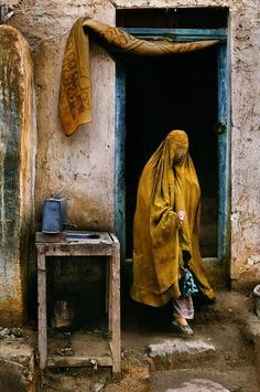 Steve McCurry A widow who is forced to beg comes out of a restaurant after having just recieved some money from a patron, Kabul, Afghanistan