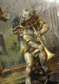Trumpeting cherub....not sure what this is make from but beautiful.