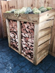 A hand-made Bluum Log Store. This medium-sized 'Midi' was made to provide an attractive yet functional and extremely useful firewood / log storage solution. The store looks great in any garden or driveway, with its unique living green roof area ready to Firewood Logs, Firewood Storage, Shed Storage, Storage Ideas, Pantry Storage, Potager Palettes, Log Shed, Wood Store, Diy Log Store