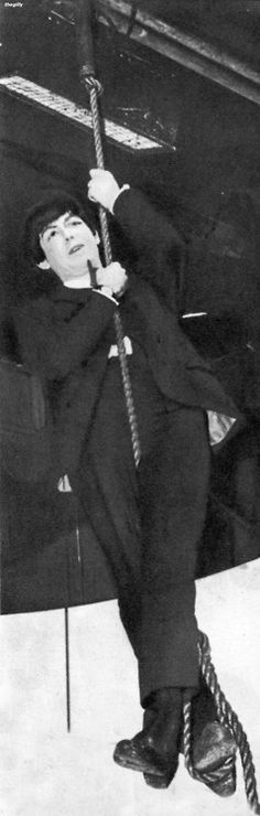 """Paul McCartney (swinging from the rafters at the Scala Theatre during the filming of A Hard Day's Night, 1964.  Scanned from """"The Beatles Film"""" souvenir magazine 1964)"""