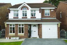 White composite door with double glazed side panel, matching PVCU windows and garage door