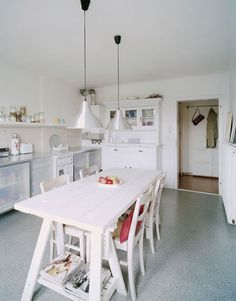 Elements of a modern country kitchen: Keep it clean, keep it open, insert a picnic table.
