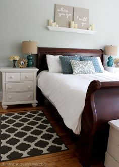 sherwin Williams Sea Salt in a room with good natural lighting. Pretty bedroom with cherry sleigh bed