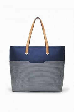 This classic navy blue Breton Stripe Tote Bag has easy-to-clean canvas and silver chevron details. Shop striped tote bags at Stella & Dot.