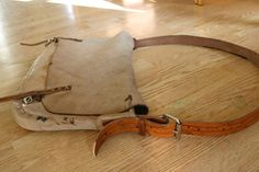 Genuine moose leather carry-all or game bag with cow leather strap with carvings!