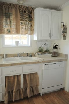 Love the old burlap bags made into curtains for the kitchen.