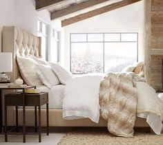 pottery barn's harper upholstered bed.  mountain chic.  faux fur.  material mix.  neutral bedroom.