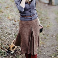 Love the sway of this skirt and fitted cardigan and skinny belt. So English on an Autumn day.