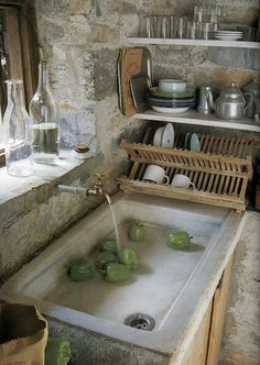 rustic walls & a very old sink.  I could see this in a small house in Italy.