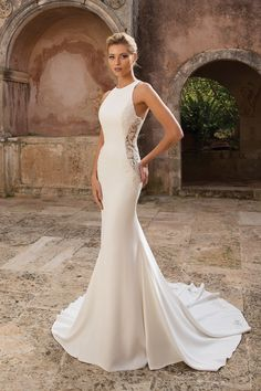 Stun your guests as you walk down the aisle in this crepe fit and flare gown that shows off your curves with illusion lace cutout side panels. Lace cutouts also on the train gives this dress a sexy edge. Available with lined side cutouts for a more conservative look.