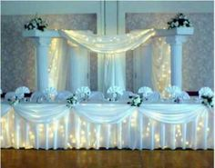 columns & lights behind drapes fabric.