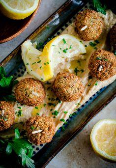 Falafel Bites with Sabra's Lemon Twist Hummus. A delicious one-bite appetizer for summer entertaining!