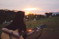 My cousin never stops playing her guitar, but she's a beauty while doing that.