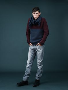 Rock your stone-washed denims with a color-block sweater from Tommy Hilfiger.