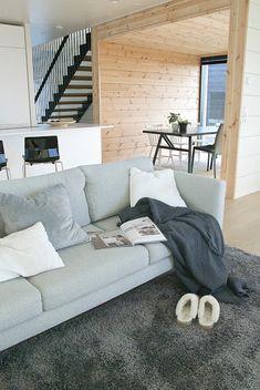 talo markki -scandinavian living room decor in a modern log house