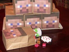 Print a screenshot of Steve's face and glue it to plain brown paper bags. Add any cube shaped candy or accessories inside. :)